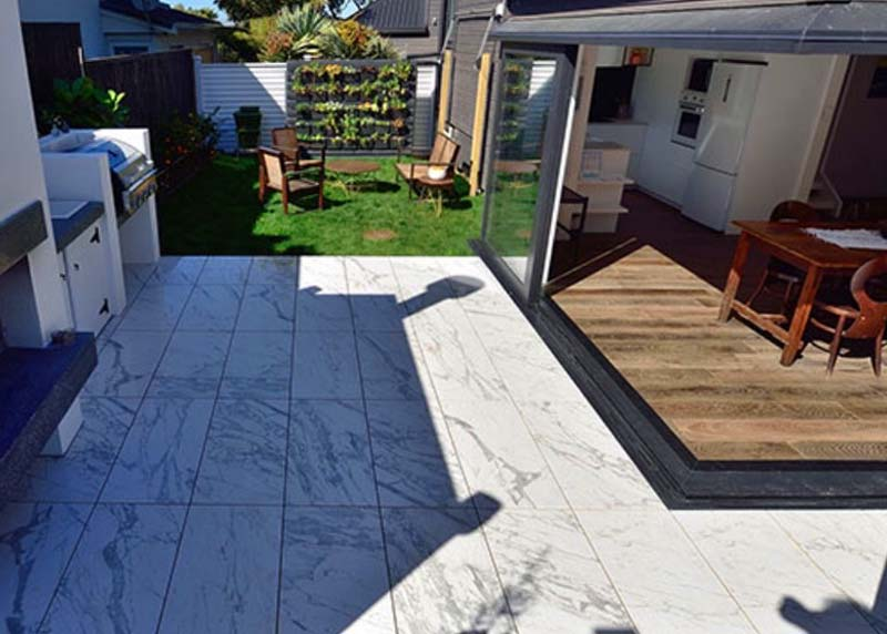 The Block 2016 outdoor week. 20mm tiles flowed into the bbq base and wood box area