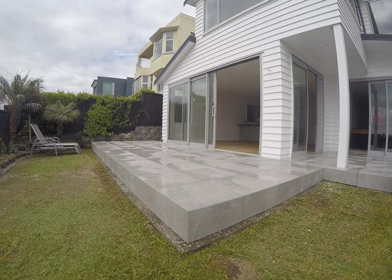 This foating deck has tile pavers installed On Nurajacks over an existing tiled patio
