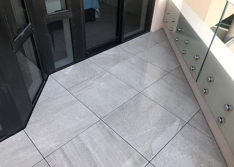 20mm tiles installed on jacks make the apartment deck a low maintenance option.
