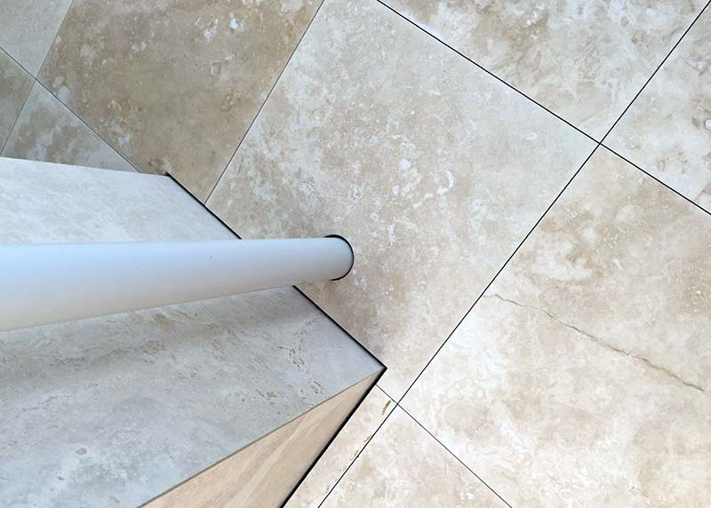 Hybrid Travertine stone with consistent negative detailing