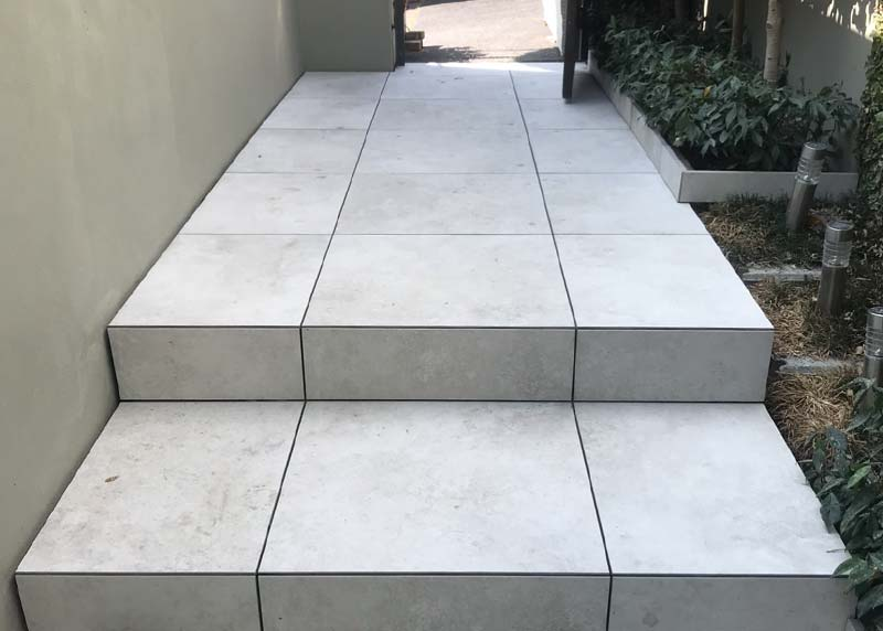 20mm tiles direct stick to concrete substrate. Mitered step edge make a neat finish.