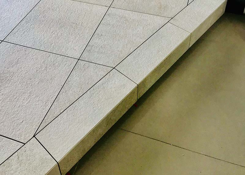 Attractive border as a step, miter edge and 20mm tile on nurajack pedestals
